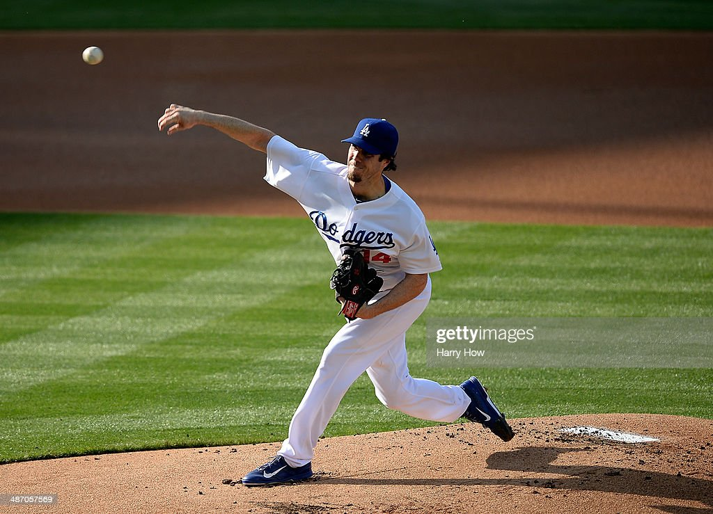 <a gi-track='captionPersonalityLinkClicked' href=/galleries/search?phrase=Dan+Haren&family=editorial&specificpeople=228587 ng-click='$event.stopPropagation()'>Dan Haren</a> #14 of the Los Angeles Dodgers pitches against the Arizona Diamondbacks during the first inning at Dodger Stadium on April 19, 2014 in Los Angeles, California.
