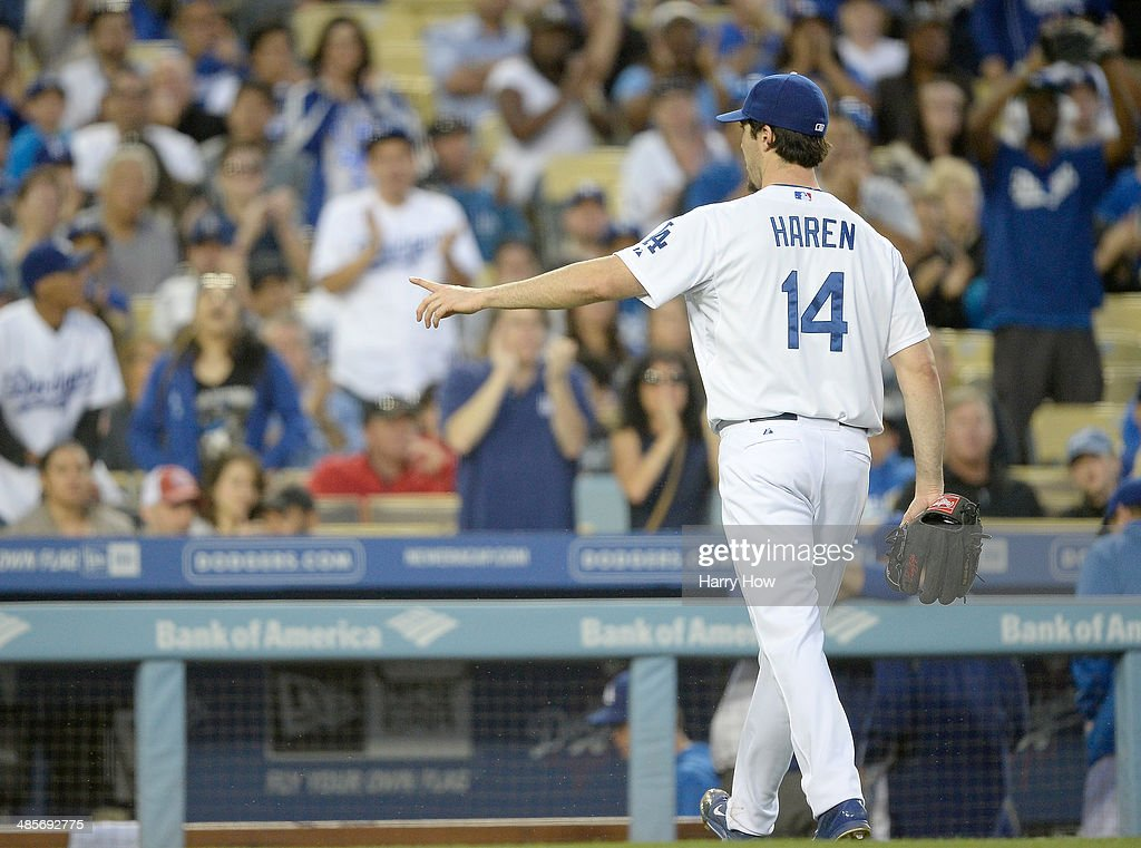 <a gi-track='captionPersonalityLinkClicked' href=/galleries/search?phrase=Dan+Haren&family=editorial&specificpeople=228587 ng-click='$event.stopPropagation()'>Dan Haren</a> #14 of the Los Angeles Dodgers reacts to applause as he leaves the game in the eighth inning against the Arizona Diamondbacks at Dodger Stadium on April 19, 2014 in Los Angeles, California.