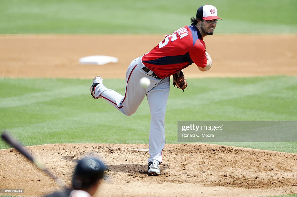 Dan Haren of the Washington Nationals pitches during a spring training game against the Florida Marlins at Roger Dean Stadium on March 26, 3012 in Jupiter, Florida.