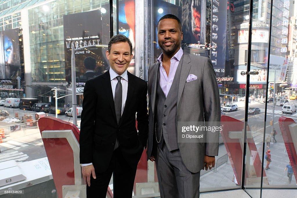 Dan Harris (L) and AJ Calloway pose on the set of 'Extra' at their New York studios at H&M in Times Square on May 26, 2016 in New York City.