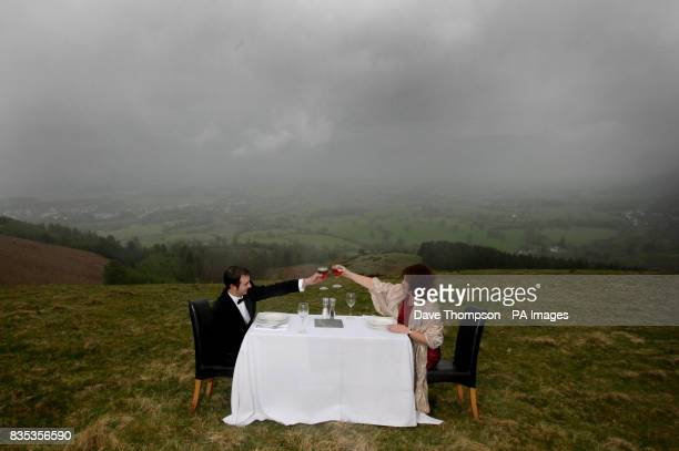 Dan Hartley and Dawn Titley enjoy a meal at the summit of Latrigg Fell in the Lake District during a photocall to promote the Keswick Mountain...