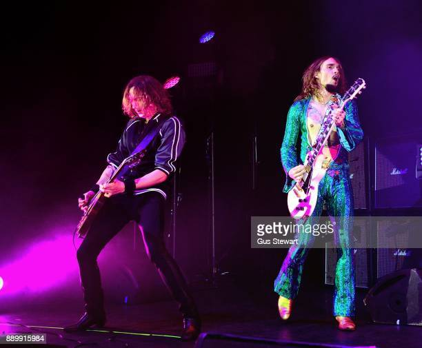 Dan Hawkins and Justin Hawkins of The Darkness perform on stage at the Eventim Apollo on December 10 2017 in London England
