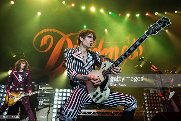 Dan Hawkins Justin Hawkins and Frankie Poullain of The Darkness perform at The Roundhouse on December 20 2015 in London England