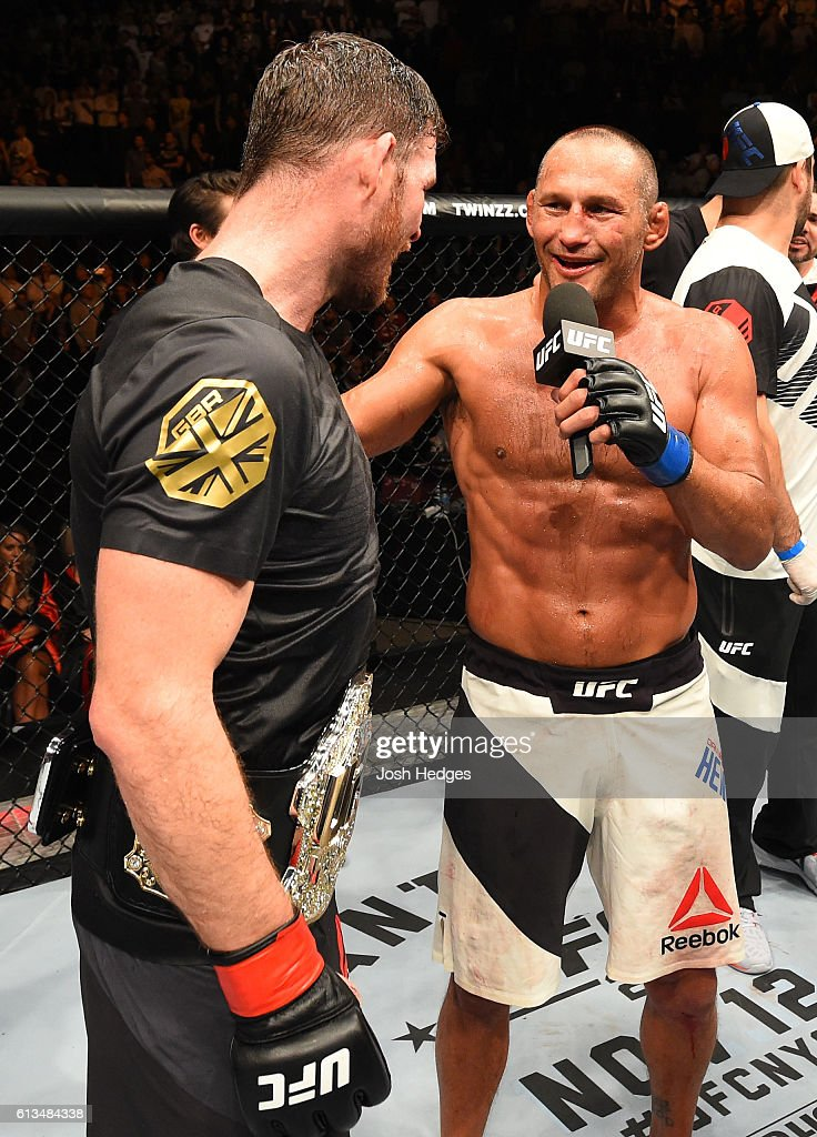 Dan Henderson chats with Michael Bisping of England after their UFC middleweight championship bout during the UFC 204 Fight Night at the Manchester Evening News Arena on October 8, 2016 in Manchester, England.