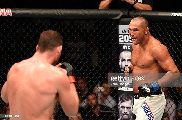 Dan Henderson circles Michael Bisping of England in their UFC middleweight championship bout during the UFC 204 Fight Night at the Manchester Evening...