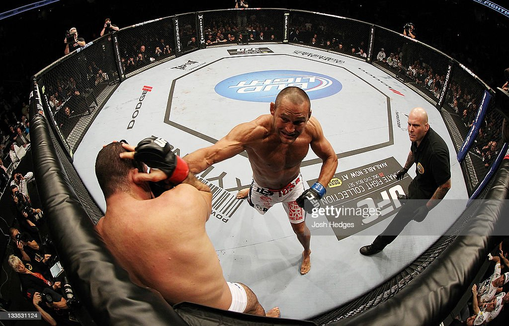 Dan Henderson punches <a gi-track='captionPersonalityLinkClicked' href=/galleries/search?phrase=Mauricio+Rua&family=editorial&specificpeople=6392259 ng-click='$event.stopPropagation()'>Mauricio Rua</a> during an UFC Light Heavyweight bout at the HP Pavillion on November 19, 2011 in San Jose, California.