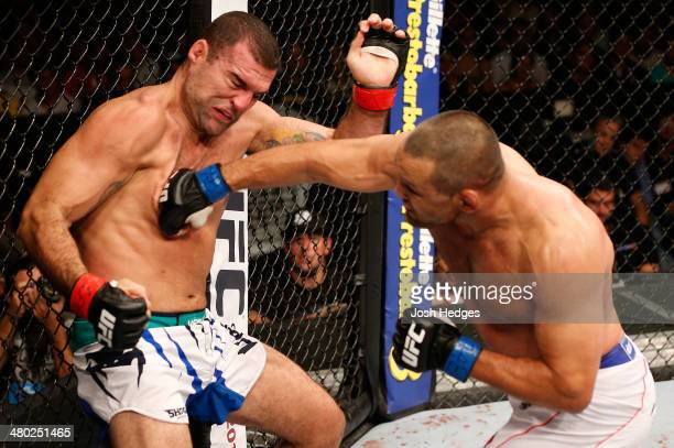 Dan Henderson punches Mauricio 'Shogun' Rua in their light heavyweight bout during the UFC Fight Night event at Ginasio Nelio Dias on March 23 2014...
