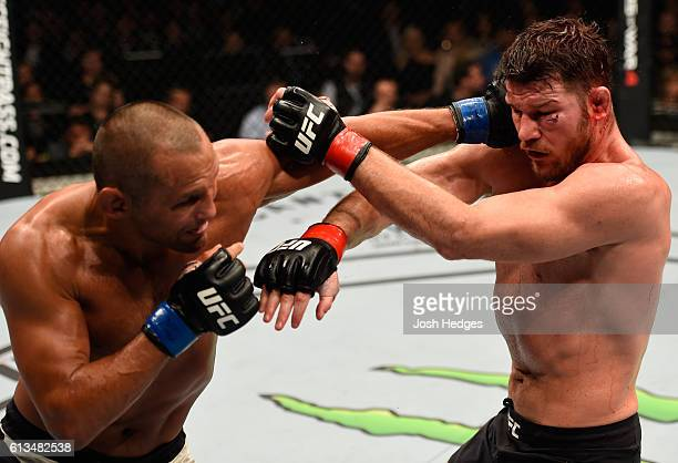 Dan Henderson punches Michael Bisping of England in their UFC middleweight championship bout during the UFC 204 Fight Night at the Manchester Evening...