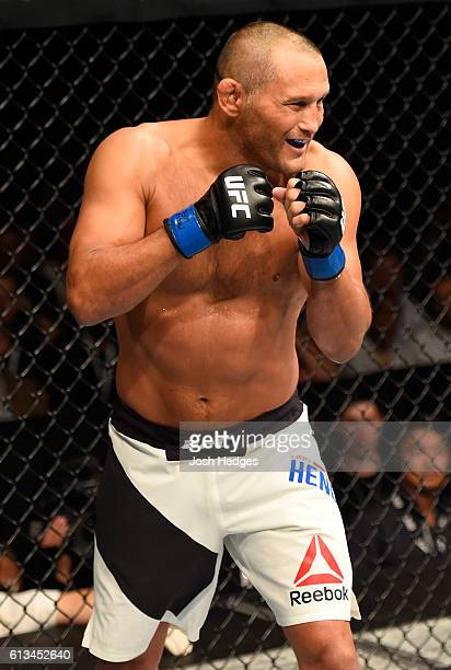 Dan Henderson smiles while facing Michael Bisping of England in their UFC middleweight championship bout during the UFC 204 Fight Night at the...