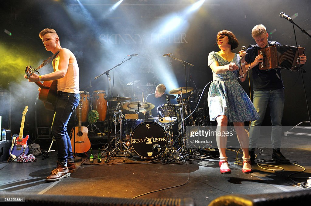 Dan Heptinstall Thom Mills Lorna Thomas and Max Thomas of British Folk Band Skinny Lister perform on stage at KOKO on July 26 2016 in London England