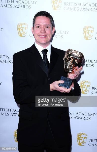 Dan Holman with the Sport award for FIFA 14 at the British Academy Games Awards at Tobacco Dock London
