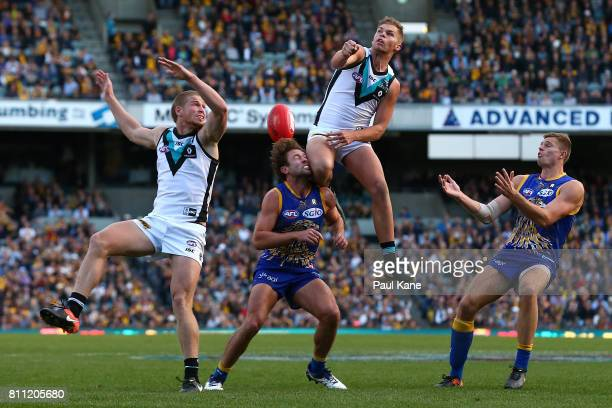 Dan Houston spoils the mark for Mark Hutchings of the Eagles during the round 16 AFL match between the West Coast Eagles and the Port Adelaide Power...