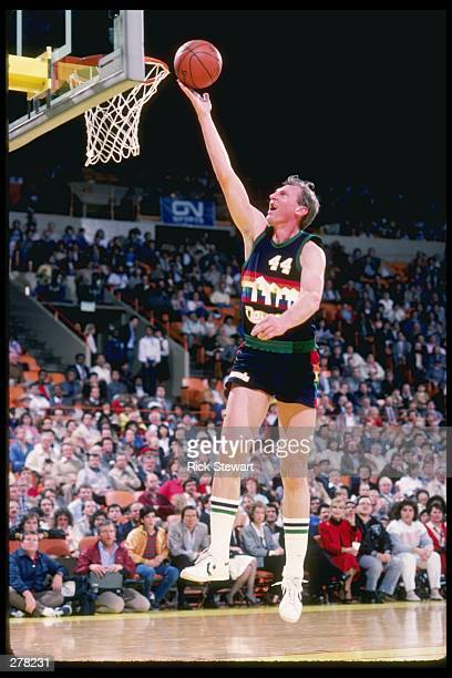 Dan Issel of the Denver Nuggets lays the ball up during the Nuggets match against the Los Angeles Lakers at the Great Western Forum in Inglewood...