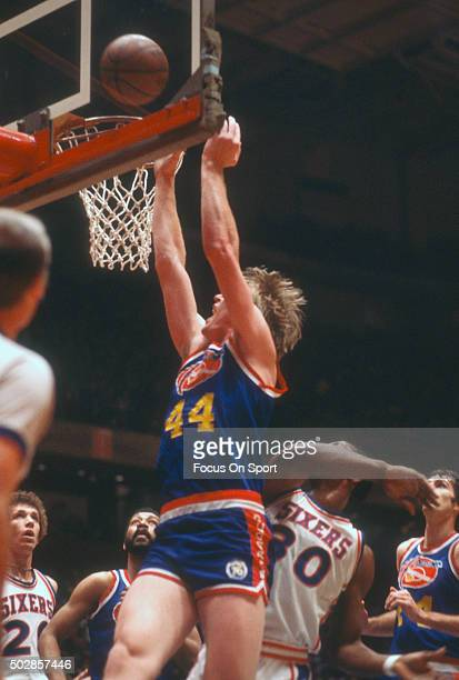 Dan Issel of the Denver Nuggets shoots over George McGinnis of the Philadelphia 76ers during an NBA basketball game circa 1977 at The Spectrum in...
