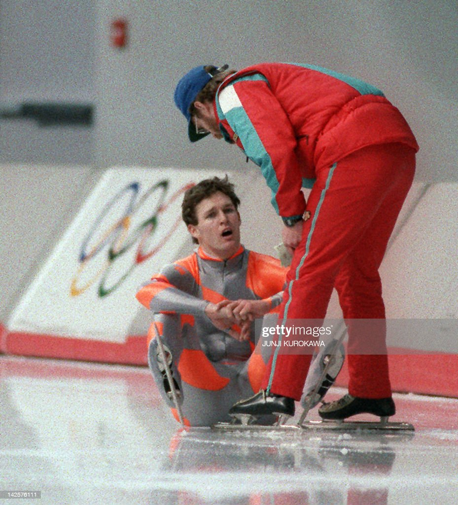 <a gi-track='captionPersonalityLinkClicked' href=/galleries/search?phrase=Dan+Jansen&family=editorial&specificpeople=235919 ng-click='$event.stopPropagation()'>Dan Jansen</a> from the United States is being comforted by his coach Mike Crowe after falling during the men's 1000m speed skating competition 19 February 1988 in Calgary at the Winter Olympic Games. Four days earlier, Jansen had learned that his sister had died of leukemia, the day he was racing in the 500m and in which he also fell.