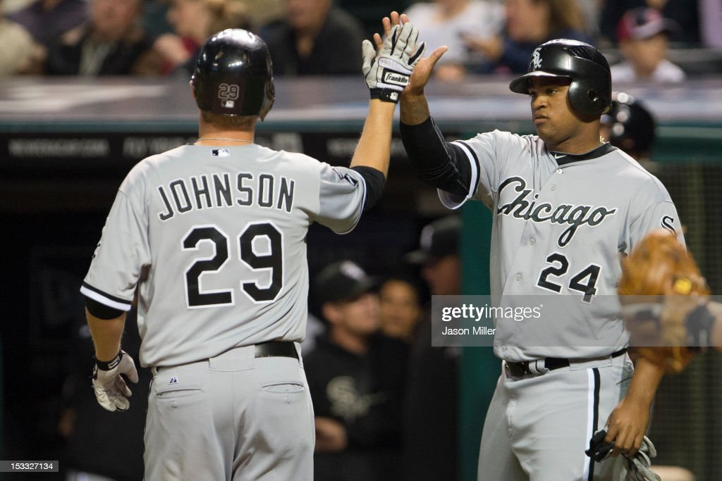 Dan Johnson #29 celebrates with Dayan Viciedo #24 of the Chicago White Sox after Johnson hit a two run home run during the second inning at Progressive Field on October 3, 2012 in Cleveland, Ohio.