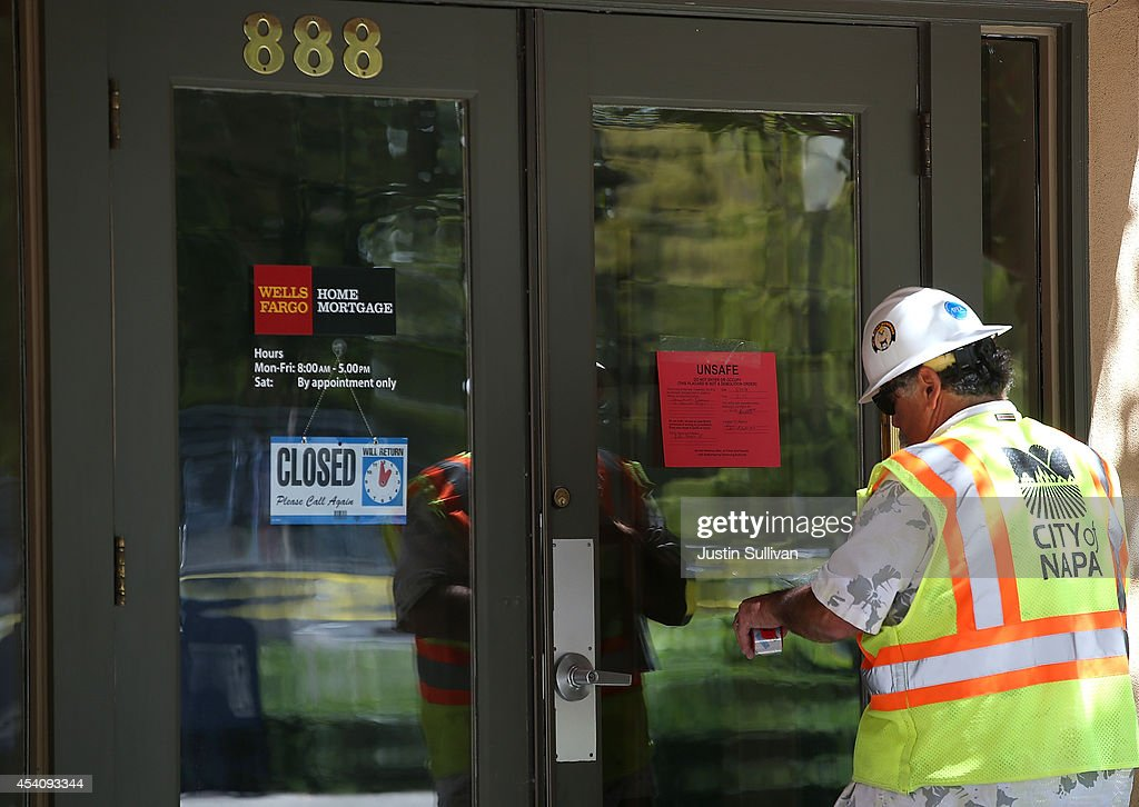 Dan Kavarian, chief building official with the City of Napa, places a red tag on a building that was damaged by a 6.0 earthquake on August 24, 2014 in Napa, California. A 6.0 earthquake rocked the San Francisco Bay Area shortly after 3:00 am on Sunday morning causing damage to buildings and sending at least 70 people to a hospital with non-life threatening injuries.