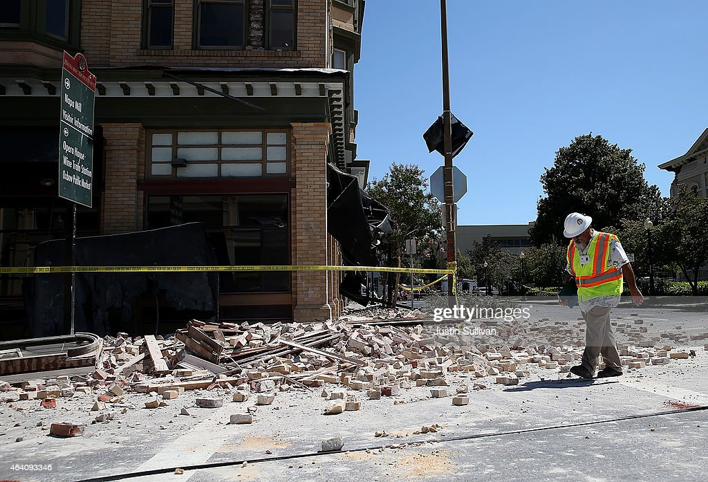 Dan Kavarian, chief building official with the City of Napa, surveys a building that was damaged by a 6.0 earthquake on August 24, 2014 in Napa, California. A 6.0 earthquake rocked the San Francisco Bay Area shortly after 3:00 am on Sunday morning causing damage to buildings and sending at least 70 people to a hospital with non-life threatening injuries.