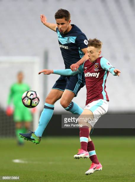 Dan Kemp of West Ham United and Callum Johnson of Middlesbrough in action during the Premier League 2 match between West Ham United and Middlesbrough...