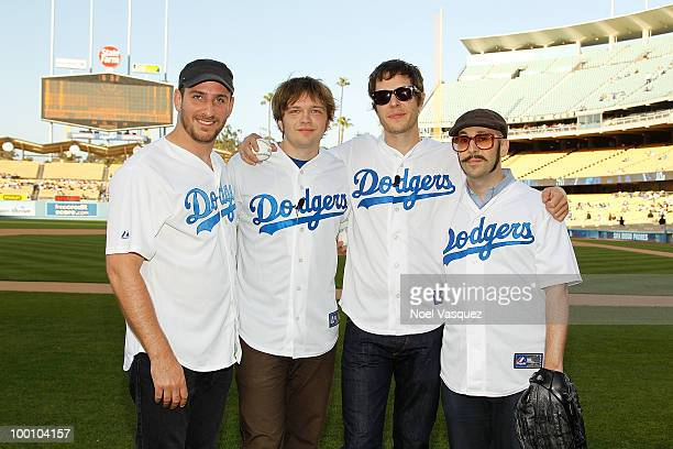 Dan Konopka Andy Ross Damian Kulash and Tim Nordwind of OK Go throws ceremonial first pitch at Dodgers Stadium on May 20 2010 in Los Angeles...