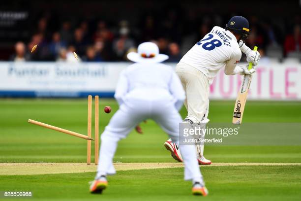 Dan Lawrence of Essex is bowled by Kemar Roach of the West Indies during the Tour Match between Essex and West Indies at Cloudfm County Ground on...