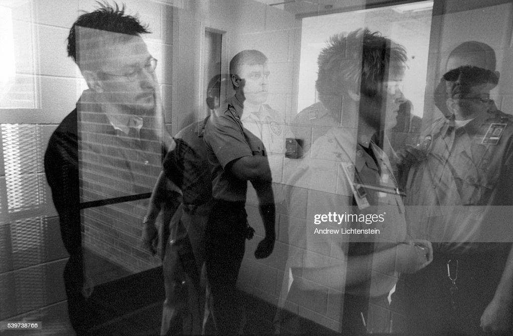 Dan Ledbetter far left enters the Warren Correctional Instution on his first day on the job as a Corrections Officer Most of Dan's fellow graduates...