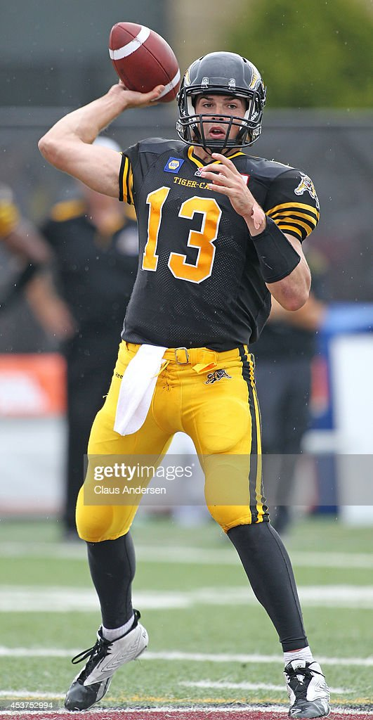 Dan LeFevour of the Hamilton TigerCats fires a pass against the Calgary Stampeders in a CFL game at Ron Joyce Stadium on August 16 2014 in Hamilton...