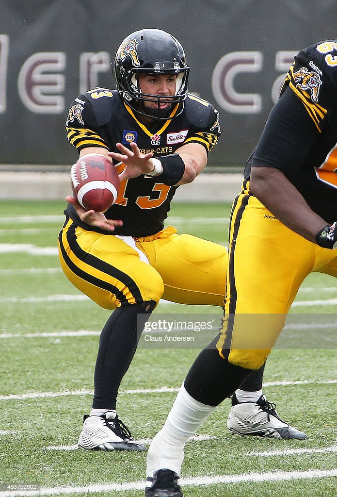 Dan LeFevour of the Hamilton TigerCats gets set to receive the ball against the Calgary Stampeders in a CFL game at Ron Joyce Stadium on August 16...
