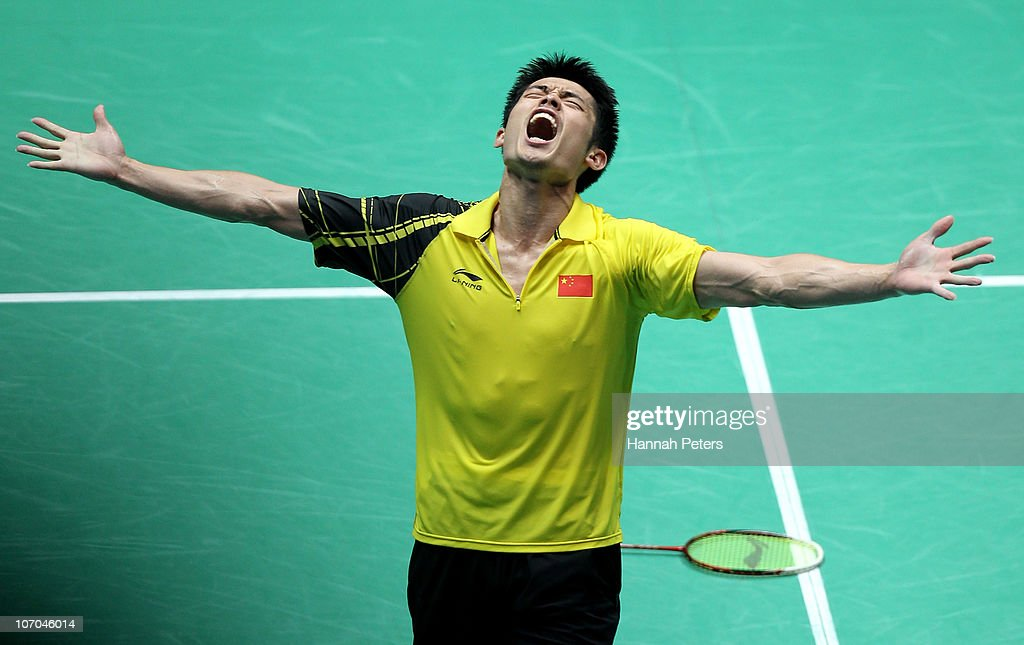 Dan Lin of China celebrates winning the gold medal in the Men's Singles Final against Chong Wei Lee of Malaysia at Tainhe Gymnasium during nine of the 16th Asian Games Guangzhou 2010 on November 21, 2010 in Guangzhou, China.