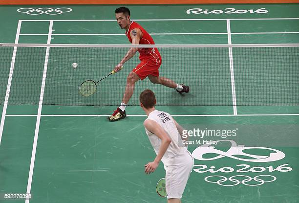 Dan Lin of China competes against Viktor Axelson of Denmark during the Men's Singles Badminton Bronze Medal match on Day 15 of the Rio 2016 Olympic...