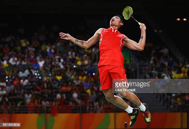 Dan Lin of China competes during the Men's Singles Badminton Semifinal against Chong Wei Lee of Malaysia on Day 14 of the Rio 2016 Olympic Games at...