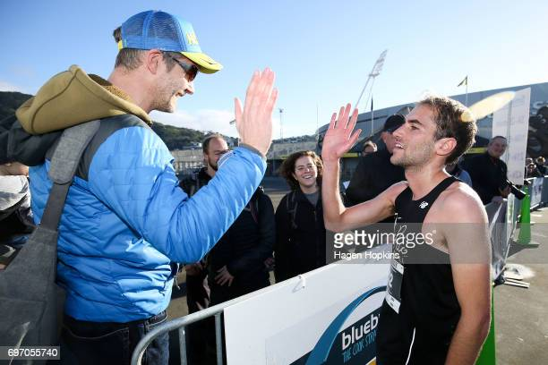 Dan Lowry of Oklahoma USA celebrates with family and friends after winning the Wellington Marathon on June 18 2017 in Wellington New Zealand