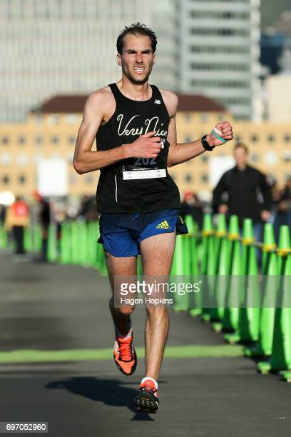 Dan Lowry of Oklahoma USA crosses the line to win the Wellington Marathon on June 18 2017 in Wellington New Zealand