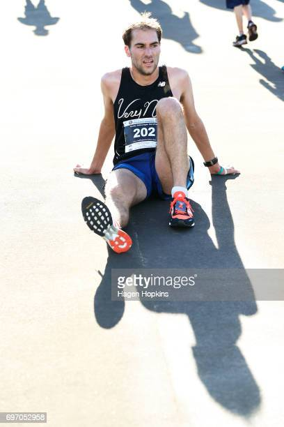 Dan Lowry of Oklahoma USA recovers after winning the Wellington Marathon on June 18 2017 in Wellington New Zealand