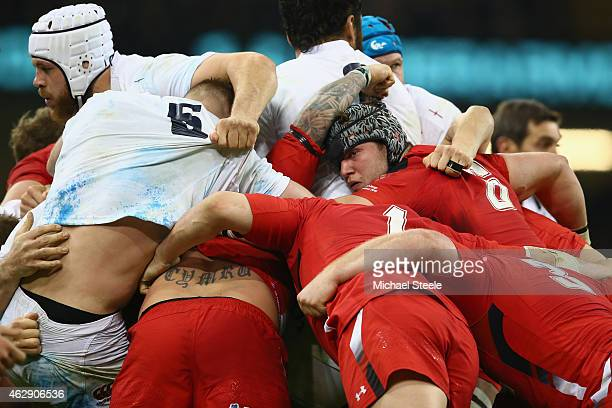 Dan Lydiate of Wales and Dave Attwood of England contest in the scrum during the RBS Six Nations match between Wales and England at the Millennium...