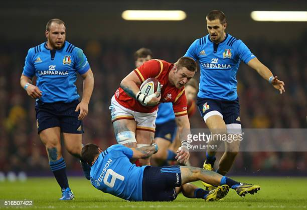 Dan Lydiate of Wales is tackled by Guglielmo Palazzani of Italy during the RBS Six Nations match between Wales and Italy at the Principality Stadium...