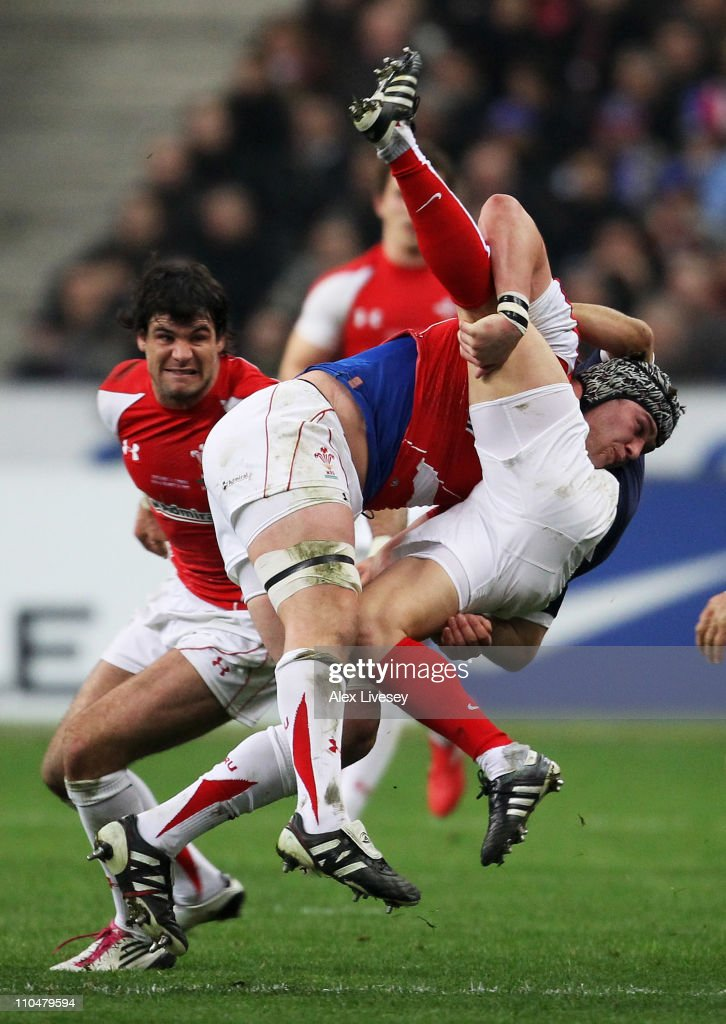 Dan Lydiate of Wales tackles Morgan Parra of France during the RBS 6 Nations Championship match between France and Wales at Stade de France on March 19, 2011 in Paris, France.