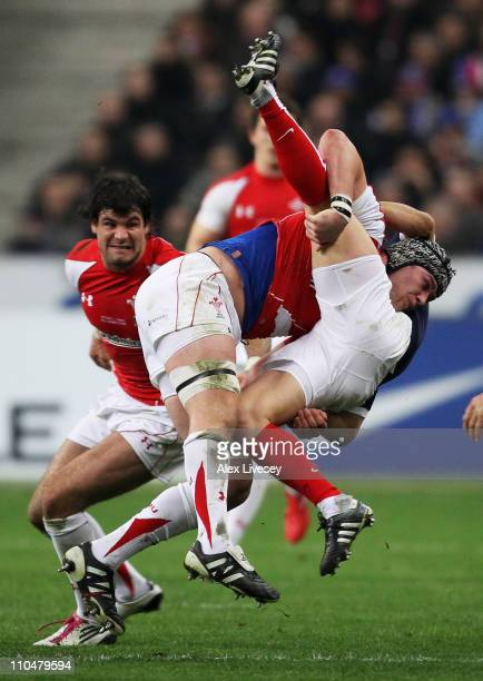 Dan Lydiate of Wales tackles Morgan Parra of France during the RBS 6 Nations Championship match between France and Wales at Stade de France on March...