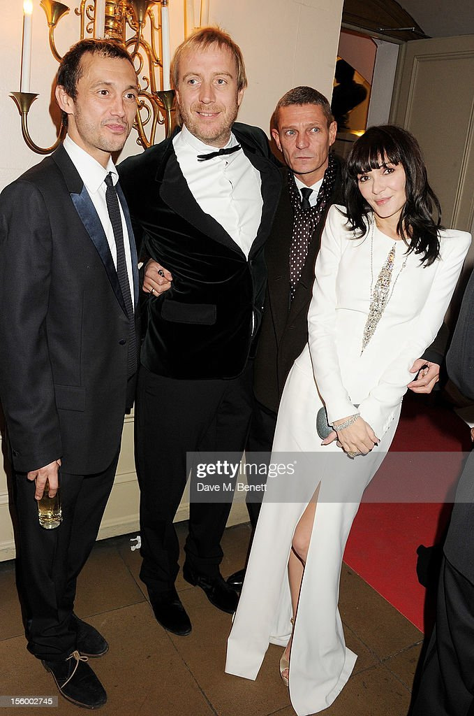 Dan Macmillan, <a gi-track='captionPersonalityLinkClicked' href=/galleries/search?phrase=Rhys+Ifans&family=editorial&specificpeople=204530 ng-click='$event.stopPropagation()'>Rhys Ifans</a>, guest and Annabelle Neilson attend the Place For Peace dinner co-hosted by Ella Krasner and Forest Whitaker to support the Peace Earth Foundation in association with Star Diamond at Banqueting House on November 10, 2012 in London, England.