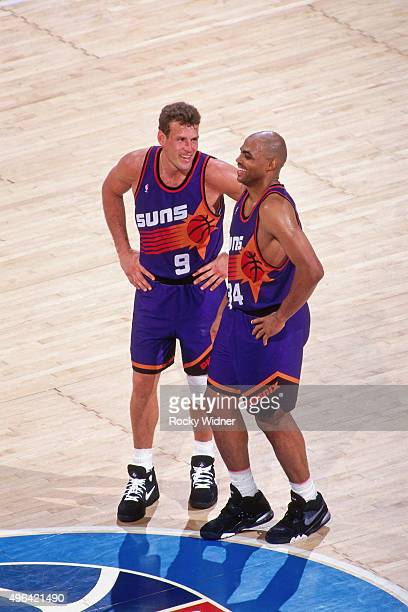 Dan Majerle and Charles Barkley of the Phoenix Suns laugh against the Sacramento Kings circa 1993 at Arco Arena in Sacramento California NOTE TO USER...