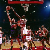 Dan Majerle of the Phoenix Suns shoots against Hakeem Olajuwon during Game Two of the Western Conference Semifinals in the 1995 NBA Playoffs on May...