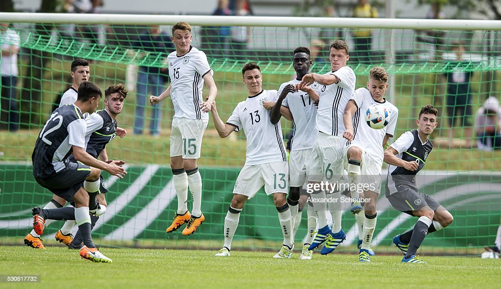Dan Mandroiu of Ireland shoots against the wall of german players during the international friendly match between Germany and Ireland on May 11 2016...
