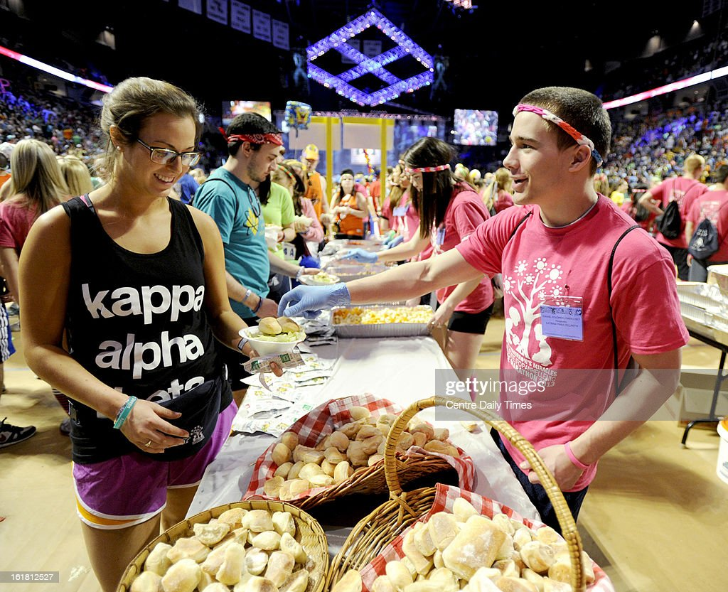 Dan Markosky and members of the hospitality committee feed the dancers during the Penn State IFC/Panhellenic Dance Marathon at the Bryce Events Center in University Park, Pennsylvania, on Saturday, February 16, 2013. Dancers started the 46-hour fundraiser on Friday. The event, known as Thon, raises money to help families that are battling pediatric cancer. Last year's event raised $10 million.