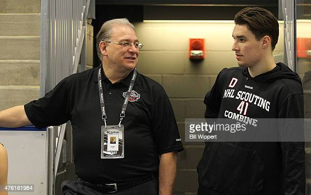 Dan Marr Director of NHL Central Scouting chats with prospect Ivan Provorov during the NHL Combine at HarborCenter on June 6 2015 in Buffalo New York