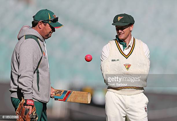Dan Marsh coach of Tasmania and George Bailey talk during day three of the Sheffield Shield match between Victoria and Tasmania at the Melbourne...