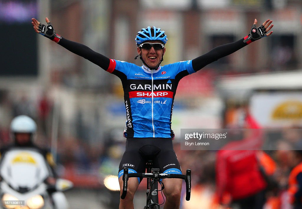Dan Martin of Ireland and Garmin Sharp celebrates as he crosses the finish line to win the 99th Liege-Bastogne-Liege cycle road race on April 21, 2013 in Liege, Belgium.