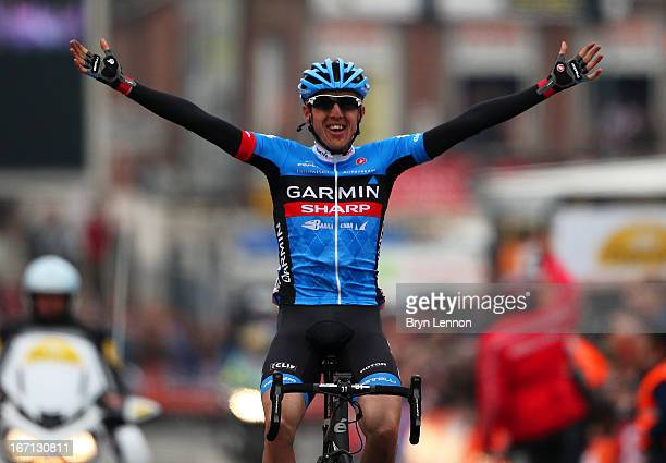 Dan Martin of Ireland and Garmin Sharp celebrates as he crosses the finish line to win the 99th LiegeBastogneLiege cycle road race on April 21 2013...