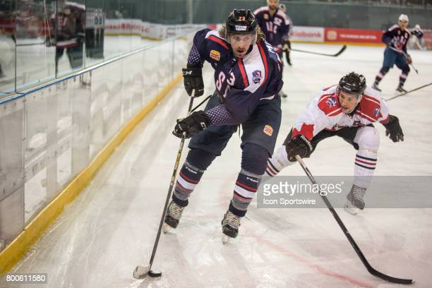Dan Milan of Team USA controls the puck in the corner of the rink during the Melbourne Game of the Ice Hockey Classic on June 24 2017 held at Hisence...