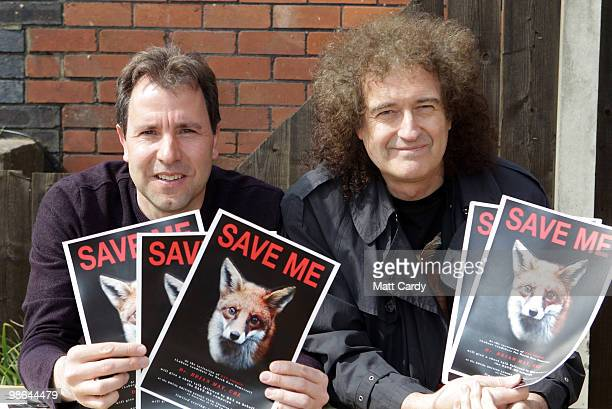 Dan Norris and Brian May founding member of the rock band Queen hold up a antifox hunting posters at the Royal British Legion on April 24 2010 in...
