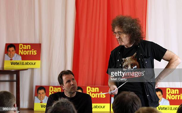 Dan Norris watches as Brian May founding member of the rock band Queen speaks at meeting at the Royal British Legion on April 24 2010 in Keynsham...